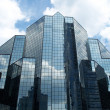 Royalty-Free Stock Photo: Modern glass building skyscrapers over blue cloudy sky