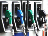 Detail of hoses of petrol pump at a gas station — Stock Photo