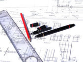 Ruler and pencil on architectural drawings — Stock Photo