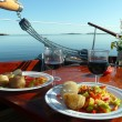 Romantic dinner on the yacht - Stock Photo