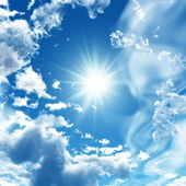 Blue sky with clouds and sun — Stock Photo