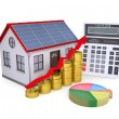 House with solar panels, calculator, schedule, and coins - Stock Photo