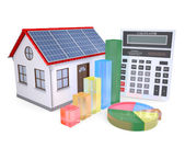 House with solar panels, a calculator and graph — Stock Photo