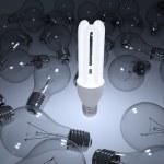 Glowing energy saving light bulb — Stock Photo