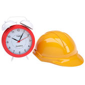 Orange helmet and clock — Stock Photo