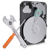 Screwdriver, wrench and disclosed hard drive — Stock Photo