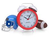 Despertador, casco de fútbol americano y bola — Foto de Stock