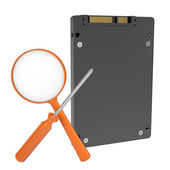 Solid-state drive, magnifier and screwdriver — Stock Photo