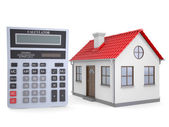 Small house and calculator — Stock Photo