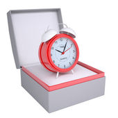 Alarm clock in open gift box — Stock Photo