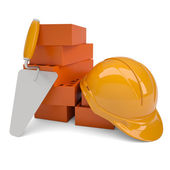 Bricks, trowel and a helmet — Stock Photo