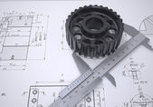 Caliper and gear in the drawing — Stockfoto