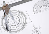 Compass and ruler on the drawing — Stock Photo