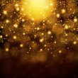 Snowflakes on abstract gold background — Stock Photo