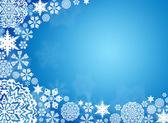 White snowflakes on a blue background — Stock Photo