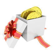 Gold coins in a gift box — Stockfoto