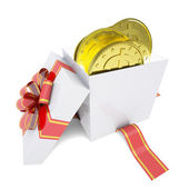 Gold coins in a gift box — Photo