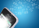 Emails fly out of smartphone screen — Stock Photo