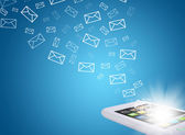 Emails fly out of smartphone screen — Stok fotoğraf