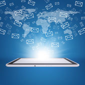 Emails fly out of tablet pc screen — Stock Photo