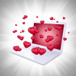 Red hearts fly out of the laptop — Stock Photo