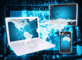 Laptop, tablet, smartphone, microcircuit and map — Stock Photo