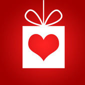 Red heart in gift. Red background — Stock Photo