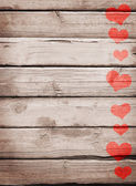 Red hearts painted on a wooden surface — Stock Photo