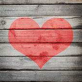 Red heart painted on a wooden surface — Foto de Stock