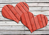 Two heart carved on a wooden surface — Stock Photo