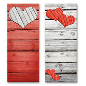 Paper hearts on a wooden surface — Stockfoto