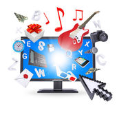 Laptop and multimedia objects — Stock Photo