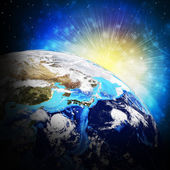 Earth planet in sun rays — Stock Photo