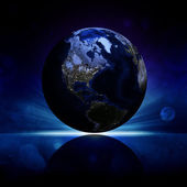 Earth planet on a reflective surface — Stock Photo