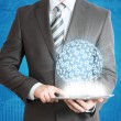 Man holding tablet pc and digital sphere in hand — Stock Photo