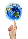 Hand goes to the planet Earth — Stockfoto