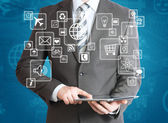 Man in suit holding tablet pc — Stock Photo