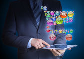 Businessman holding a tablet in his hands — Stock Photo