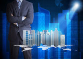 Man in suit and city of skyscrapers — Stock Photo