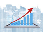 Tablet pc and growth chart on screen tablet — Stock Photo
