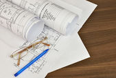 Construction drawings, glasses and pen — Stock Photo