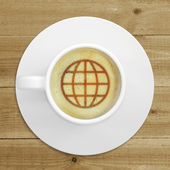 Picture of the globe in the coffee foam — Stock Photo