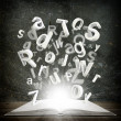 Letters are emitted from an open book — Stockfoto