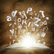 Letters are emitted from an open book — Foto Stock