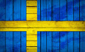 Sweden flag painted on wooden boards — Stock Photo