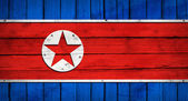 North Korea flag painted on wooden boards — Stock Photo