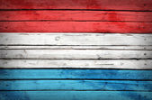 Luxembourg flag painted on wooden boards — Stock Photo