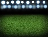 スポット ライトに照らされた夜のフットボール競技場 — ストック写真