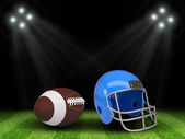 Football ball and helmet in the middle of field — Foto de Stock
