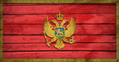 Montenegro flag painted on wooden boards — Stock Photo